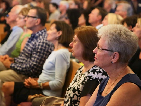 Friends, family and members of the public gather at Sacred Heart Church in Palm Desert, Calif., for the funeral of Barbara Sinatra, Tuesday, August 1, 2017.