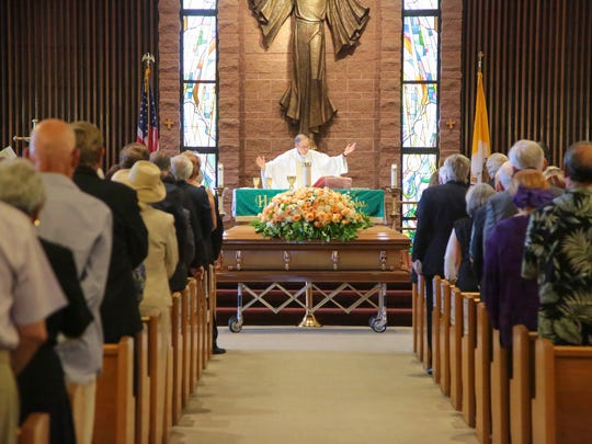Friends, family and members of the public gather at Sacred Heart Catholic Church in Palm Desert, Calif., for the funeral of Barbara Sinatra, Tuesday, August 1, 2017.