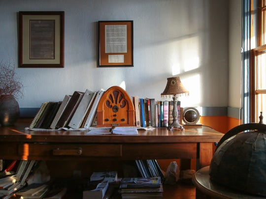 Books are stacked on a table in the Nipton Hotel, Wednesday,