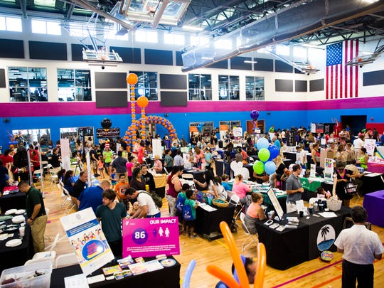 Parents and children make their way through the booths during the Back to School Expo on Saturday, August 12, 2017 at the Greater Naples YMCA in North Naples. The event featured more than 55 vendors, offering information on goods and services families need for the school year.