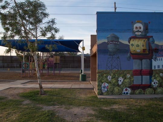 The border wall flanks a neighborhood in Calexico,