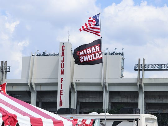 Ole Glory and Ragin Cajun flags fly proudly Saturday at  Cajun Field ahead of the Ragin' Cajuns game against the Warhawks. Tailgating is the preferred way to spend the time leading up to the game.