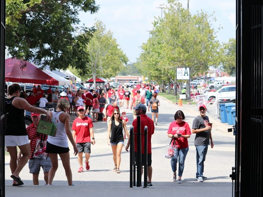 Fans enjoy tailgating at Cajun Field in Lafayette before game time.