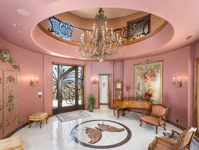 The home has soaring ceilings as high as 24 feet, two