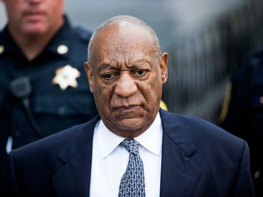 A woman is asking a federal appeals court to reinstate a lawsuit accusing comedian Bill Cosby, shown leaving the Montgomery County Courthouse in August, of defaming her when his representative disputed a news story about her rape allegations.