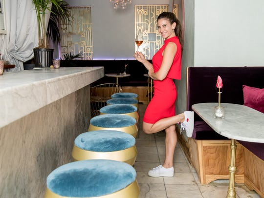 Ariel Arce, owner of Air Champagne Bar, kicks back