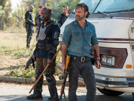 "In this image released by AMC, Lennie James portrays Morgan Jones, left, and Andrew Lincoln portrays Rick Grimes in a scene from ""The Walking Dead."""