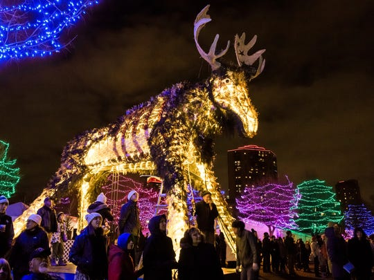 """This 2016 image provided by Holidazzle shows a lit-up sculpture called """"Wolf & Moose,"""" featured last year as well as this year in the 2017 Holidazzle event in Loring Park in Minneapolis. The event is one of a number of holiday festivals around the U.S. (Erin Smith Photography/ Holidazzle via AP)"""