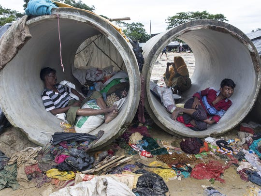 Rohingya refugees rest inside a cement cylinder while a lack of shelters continues to be a massive problem on Sept. 17, 2017 in Kutupalong, Cox's Bazar, Bangladesh.