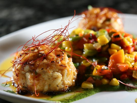 The Crab Cake with squash succotash served at Mesh.