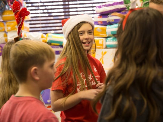 Taylor Clugston talks with friends Friday at the Grace Place Pregnancy and Health Center in Farmington.