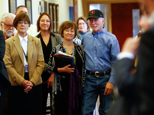 Judge Sandra Price stands next to her husband Mike Kilpatrick during her retirement ceremony on Tuesday at Aztec District Court.