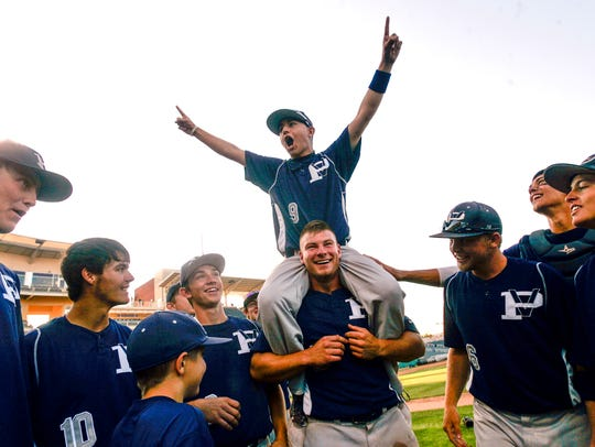 Justin Solomon celebrates with his Piedra Vista High School teammates after the Panthers won the 4A state championship against Miyamura on May 12, 2012, at Isotopes Park in Albuquerque.