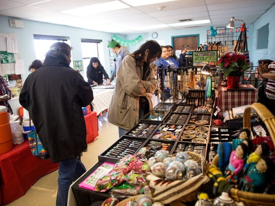 Customers check out the merchandise Friday at the Shiprock Chapter Christmas Bazaar at the Shiprock Chapter House.