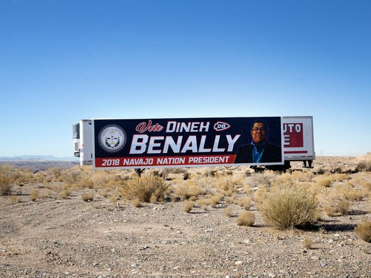 A campaign sign for Dineh Benally sits in an open lot on Friday west of Farmington.