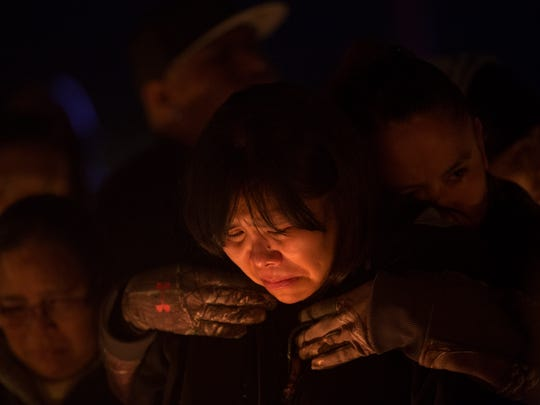Theodora Hayes the mother of Mitchual Sam and Hjordis Sam mourns the loss of her children during a candlelight vigil on Friday 2017 in Kirtland.