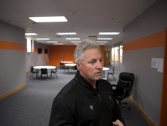 Aztec Superintendent Kirk Carpenter talks about the new commons area on Friday at Aztec High School.