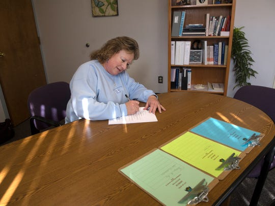 Incumbent City Commissioner Sheri Rogers fills out paperwork for her re-election bid on Tuesday at the Aztec city clerk's office at City Hall.