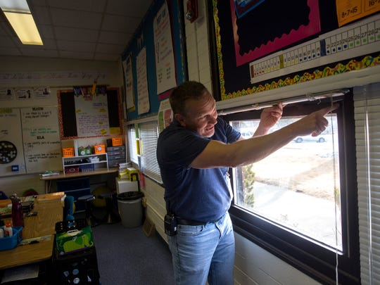 Principal Shannon Waller points out problems with a classroom window on Friday during a tour of Country Club Elementary School in Farmington.