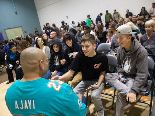 Former gang member Jorge Cuevas, left, talk with Dominic Cage and Stephen Aragon, and his nephews Jorge Cuevas and Arturo Cuevas on Thursday before his presentation at the Sycamore Park Community Center in Farmington.