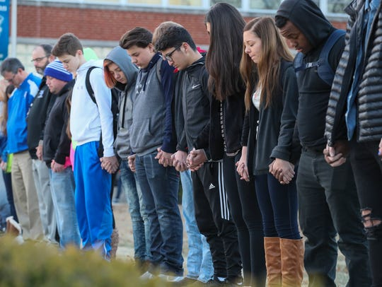 A prayer circle at Paducah Tilghman High School held