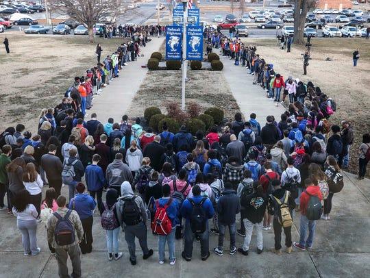 A prayer circle at Paducah Tilghman High School held