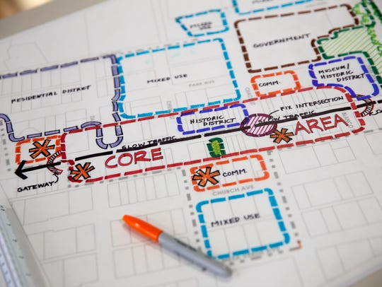 A diagram of the city is displayed on a table Thursday during a Metropolitan Redevelopment Area meeting in downtown Aztec.
