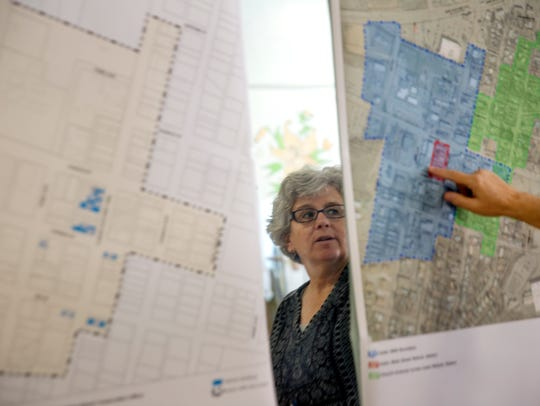 Project manager Jackie Fishman, a principal at Consensus Planning, talks about Aztec's Metropolitan Redevelopment Area plans  on Thursday in downtown Aztec.