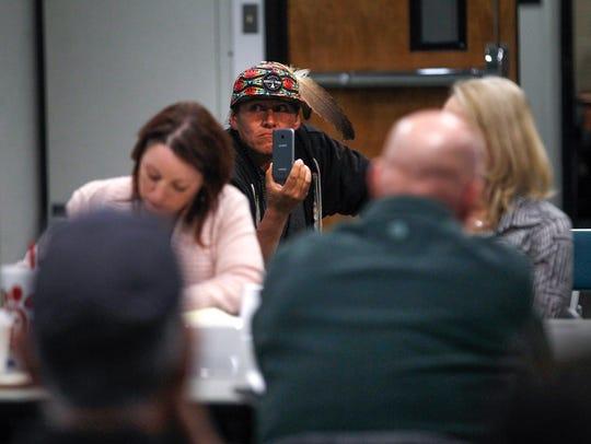 Orlando Cruz records public comments during a Bureau of Land Management Advisory Council meeting on Tuesday, Jan. 30,  at San Juan College in Farmington.
