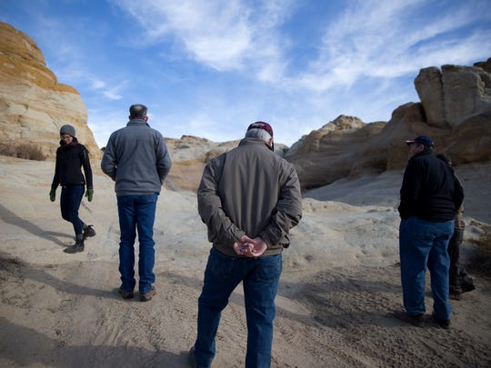 Mick O'Neill, a member of the Bureau of Land Management Advisory Council, center, tours a section of the Brown Spring Campground rock crawl area during a public tour on Wednesday north of Farmington.