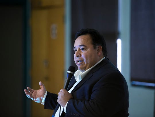 Luis Gallegos, an attorney with the Southwest Region of the United States Federal Trade Commission, gives a presentation on consumer rights when buying funeral goods and services on Thursday at the Shiprock Chapter house.
