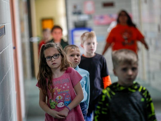Students walk to class on Feb. 16 at Lydia Rippey Elementary School in Aztec.