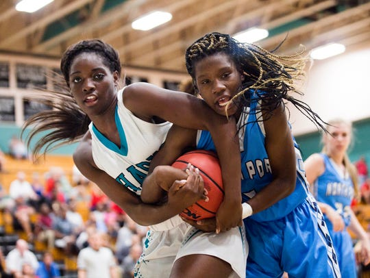 Gulf Coast junior Sydney Eugene and North Port sophomore Emani Jefferson fight over the ball during the Class 8A regional quarterfinal against North Port High School on Tuesday, Feb. 20, 2018 at Gulf Coast High School.