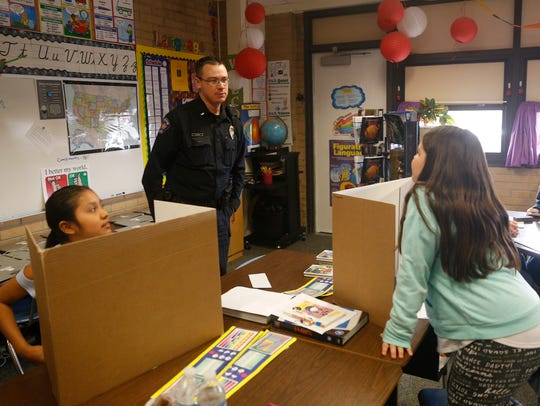 Farmington Police Department Lt. Chad Byers talks with Mesa Verde Elementary School students during a visit on Friday in Farmington.