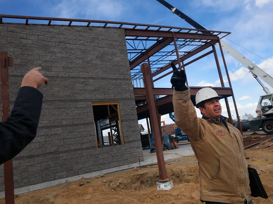 Jeffrey Cillessen, president of B & M Cillessen Construction Co. Inc., discusses some of the features of the new GoTo Plaza in Farmington on Thursday.