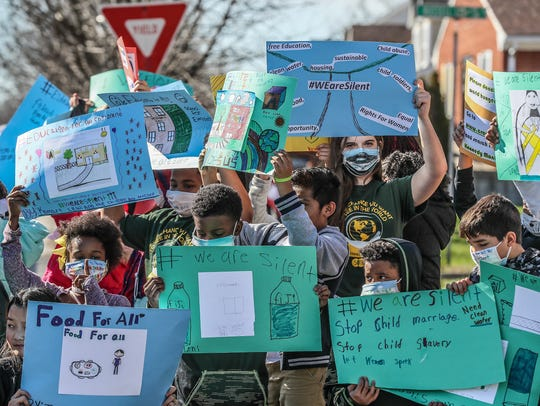 Students at Kennedy Montessori marched around the school and around Park DuValle neighborhood on Friday afternoon wearing masks and carrying signs as part of the #WeAreSilent week of learning.