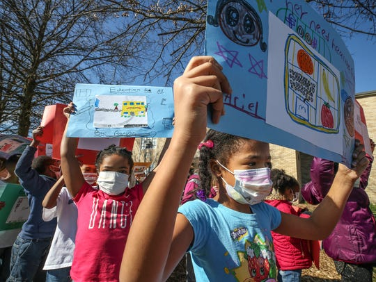 Students at Kennedy Montessori marched around the school