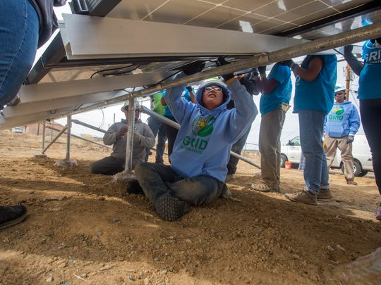 Cassandra Valandra, a construction fellow in the SolarCorps Fellowship Program, connects wires for a solar project on Wednesda at the Ojo Encino Chapter house.