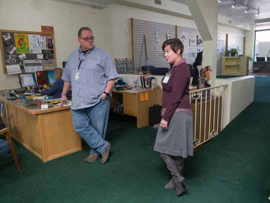 Michael Bulloch of the Farmington Downtown Association and Complete Streets program project coordinator Sherry Roach are interviewed March 19 in the Complete Streets headquarters at 119 West Main Street in Farmington.