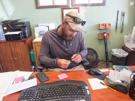 Fishing guide Marcus Rubbo works Friday at Fisheads San Juan River Lodge at Navajo Dam.