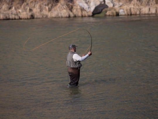Frank Lorenzo fishes Friday at the Texas Hole on the San Juan River at Navajo Dam.