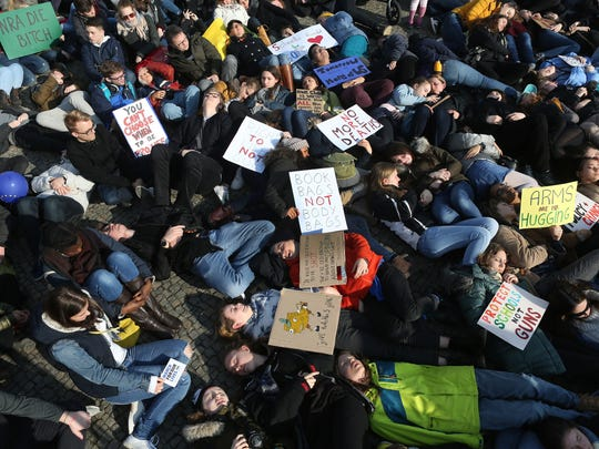 Demonstrators lay on the ground in protest at the March