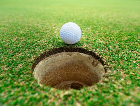 golf ball on hole..beautiful golf course on hill in big club. Golf sport is outdoor sport. It is popular game.