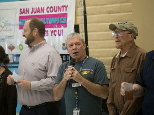 Jack Lowery, center, the adult programs manager for the Bonnie Dallas Senior Center, introduces San Juan County Senior Olympics board members and athletes during the opening ceremony on Monday at the Bonnie Dallas Senior Center in Farmington.