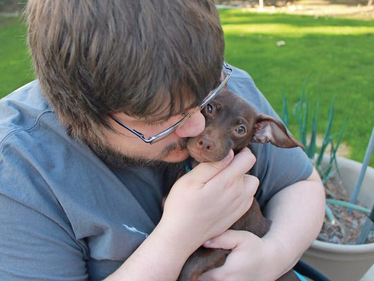Alex Knaak suffered a debilitating spinal cord bleed that left him partially paralyzed. Adopting Loki has helped him reach out to others for help and live a fuller life.