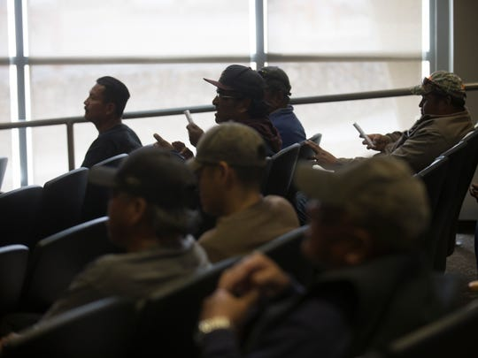 Navajo Nation residents vote during a community meeting Thursday at the John Pinto Library at Diné College in Shiprock.
