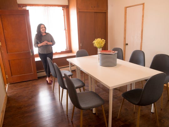 Melissa Porch shows off the conference room Friday at at her business, North Allen Coworking and Venue in Farmington.