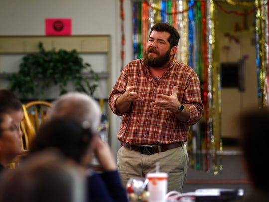 Adrien Lawyer, co-director of the Transgender Resources Center of New Mexico, delivers a presentation Dec. 23 at the Identity Inc. community center in Farmington.