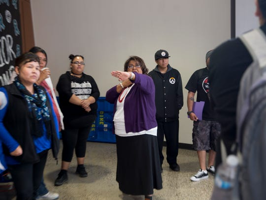 Dine College's Lavine Blackmountain addresses a question to self-defense instructor Donny Moore Thursday during a Sexual Assault Awareness and Prevention Month conference at the Sen. John Pinto Library at Dine College in Shiprock.