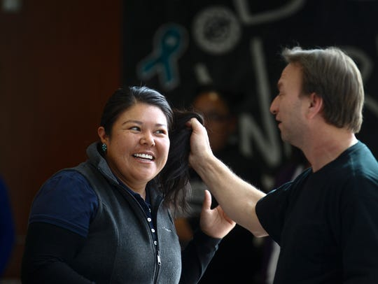 Dine College student Laurel Antonio assists self defense instructor Donny Moore during a Sexual Assault Awareness and Prevention Month conference Thursday at the Sen. John Pinto Library at Dine College in Shiprock.